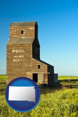 south-dakota map icon and an old grain elevator